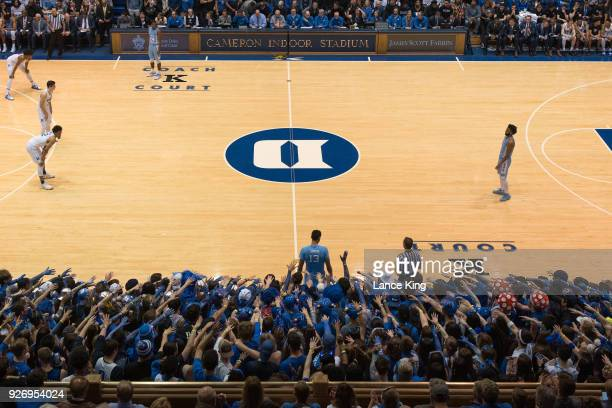 Cameron Crazies and fans of the Duke Blue Devils taunt Cameron Johnson of the North Carolina Tar Heels at Cameron Indoor Stadium on March 3 2018 in...