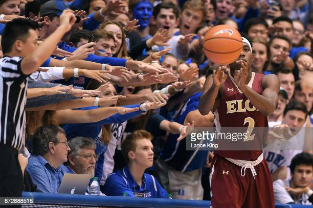 Cameron Crazies and fans of the Duke Blue Devils taunt Dmitri Thompson of the Elon Phoenix at Cameron Indoor Stadium on November 10 2017 in Durham...
