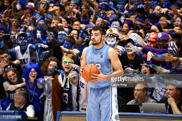 Cameron Crazies and fans of the Duke Blue Devils taunt Luke Maye of the North Carolina Tar Heels at Cameron Indoor Stadium on February 20 2019 in...