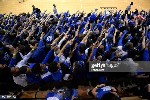 Cameron Crazies and fans of the Duke Blue Devils taunt players of the North Carolina Tar Heels at Cameron Indoor Stadium on March 3 2018 in Durham...