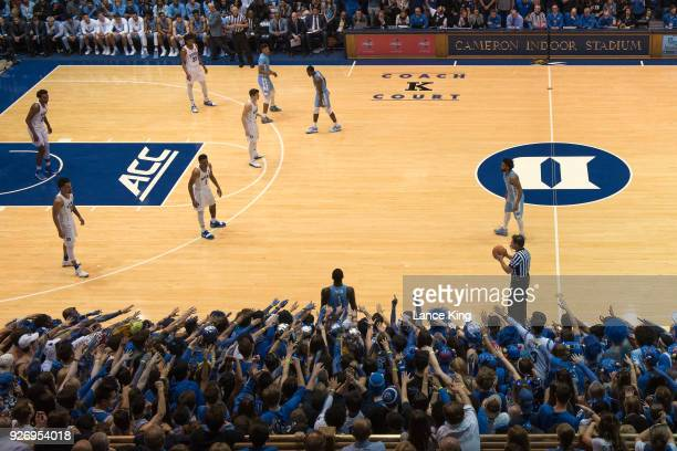 Cameron Crazies and fans of the Duke Blue Devils taunt Theo Pinson of the North Carolina Tar Heels at Cameron Indoor Stadium on March 3 2018 in...