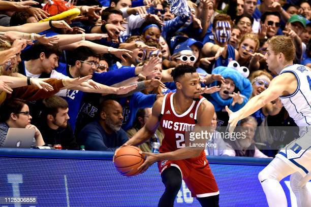Cameron Crazies and fans of the Duke Blue Devils taunt Torin Dorn of the North Carolina State Wolfpack in the second half at Cameron Indoor Stadium...