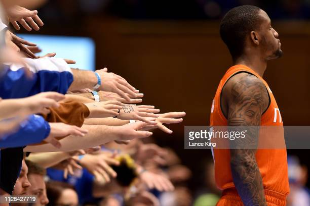 Cameron Crazies and fans of the Duke Blue Devils taunt Zach Johnson of the Miami Hurricanes in the second half at Cameron Indoor Stadium on March 2...