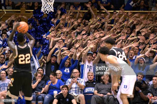 Cameron Crazies and fans of the Duke Blue Devils try to distract Deng Adel of the Louisville Cardinals at Cameron Indoor Stadium on February 21 2018...