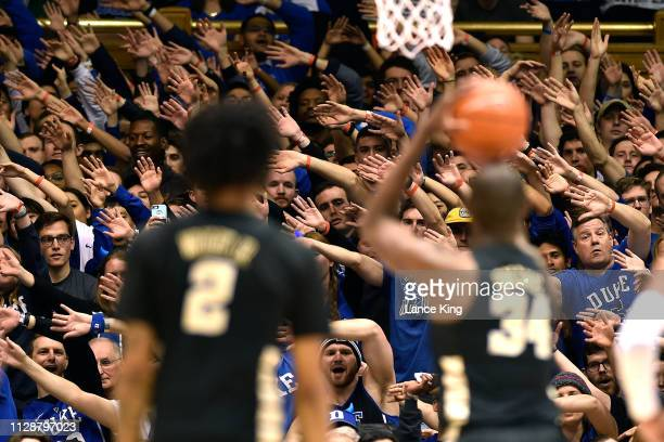 Cameron Crazies and fans of the Duke Blue Devils try to distract Sunday Okeke of the Wake Forest Demon Deacons in the first half at Cameron Indoor...