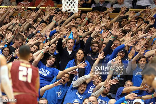 Cameron Crazies and fans of the Duke Blue Devils try to distract Olivier Hanlan of the Boston College Eagles during their game at Cameron Indoor...