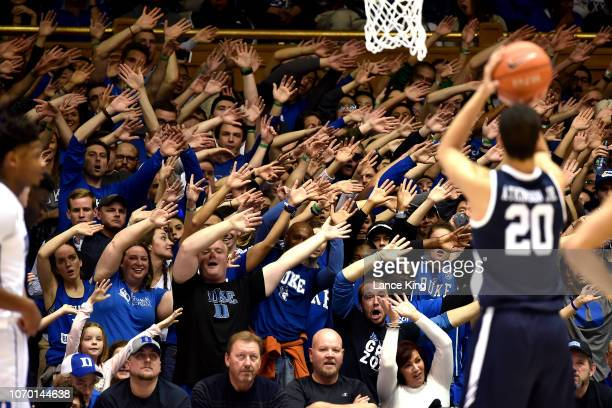 Cameron Crazies and fans of the Duke Blue Devils try to distract Paul Atkinson of the Yale Bulldogs in the second half at Cameron Indoor Stadium on...