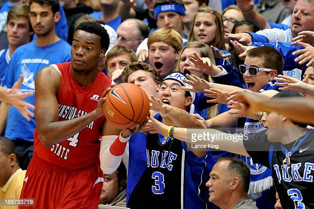 Cameron Crazies of the Duke Blue Devils try to distract Kimani Hunt of the WinstonSalem State Rams at Cameron Indoor Stadium on November 1 2012 in...