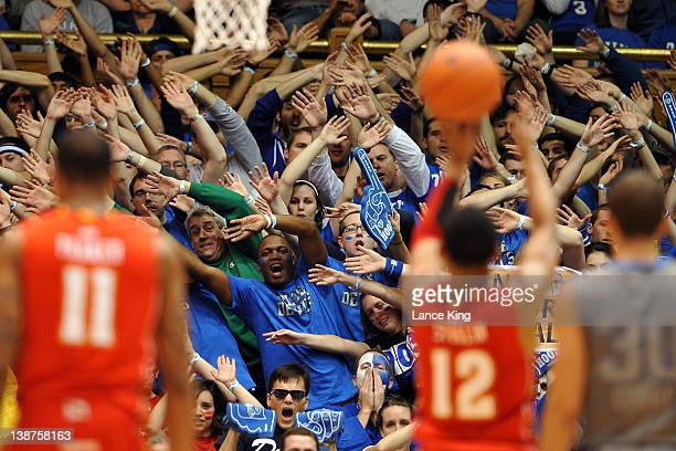 Cameron Crazies of the Duke Blue Devils try to distract Terrell Stoglin of the Maryland Terrapins during a free throw attempt in the first half at...