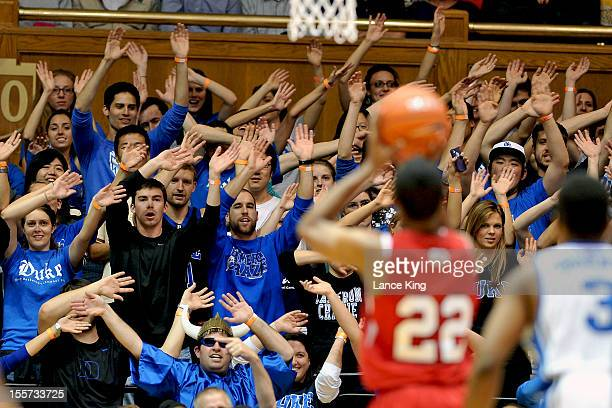 Cameron Crazies of the Duke Blue Devils try to distract WyKevin Bazemore of the WinstonSalem State Rams at Cameron Indoor Stadium on November 1 2012...
