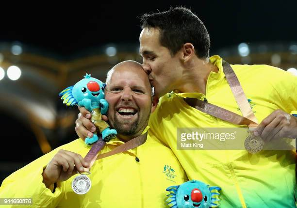 Cameron Crombie of Australia celebrates his gold medal by kissing siler medalist Marty Jackson during the Men's F38 Shot put final during athletics...
