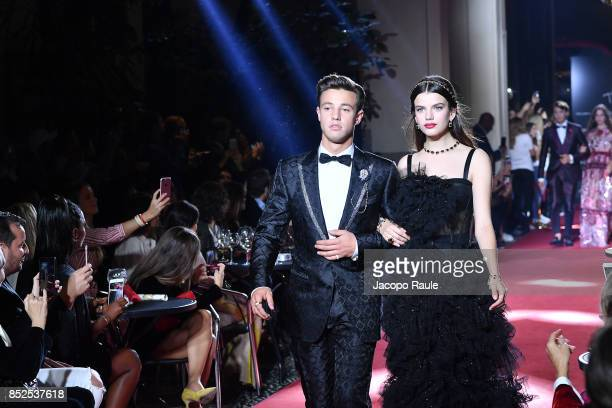 Cameron Dallas and Sonia Ben Ammar walk the runway at the Dolce Gabbana secret show during Milan Fashion Week Spring/Summer 2018 at Bar Martini on...