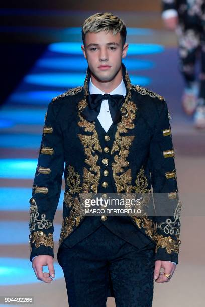 Cameron Dallas presents a creation for fashion house Dolce Gabbana during the Men's Fall/Winter 2019 fashion shows in Milan on January 13 2018 / AFP...