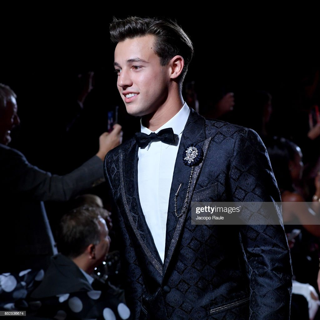 Cameron Dallas walks the runway at the Dolce & Gabbana secret show during Milan Fashion Week Spring/Summer 2018 at Bar Martini on September 23, 2017 in Milan, Italy.