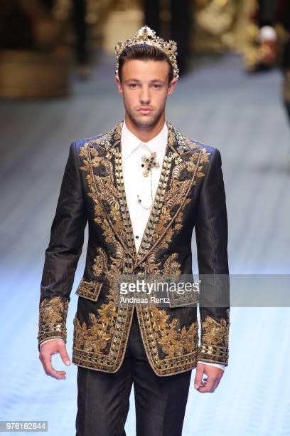 Cameron Dallas walks the runway at the Dolce Gabbana show during Milan Men's Fashion Week Spring/Summer 2019 on June 16 2018 in Milan Italy