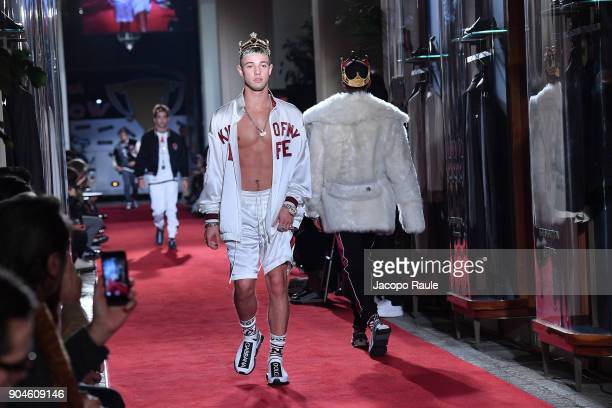 Cameron Dallas walks the runway at the Dolce Gabbana Unexpected Show show during Milan Men's Fashion Week Fall/Winter 2018/19 on January 13 2018 in...