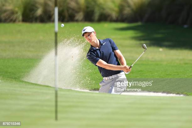 Cameron Davis of Australia plays a bunker shot on the 15th hole during day four of the 2017 Australian Golf Open at The Australian Golf Club on...