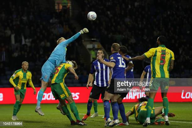 Cameron Dawson of Sheffield Wednesday climbs above Harvey Barnes of West Bromwich Albion to punch the ball clear of danger during the Sky Bet...