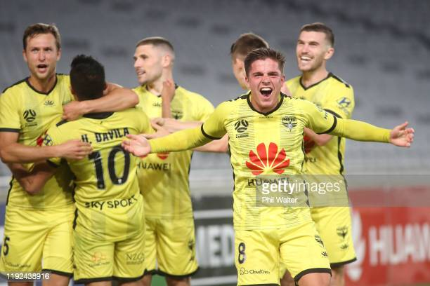 Cameron Devlin of the Wellington Phoenix celebrates the goal to Ulises Alejandro Davila Plascencia during the round nine A-League match between the...