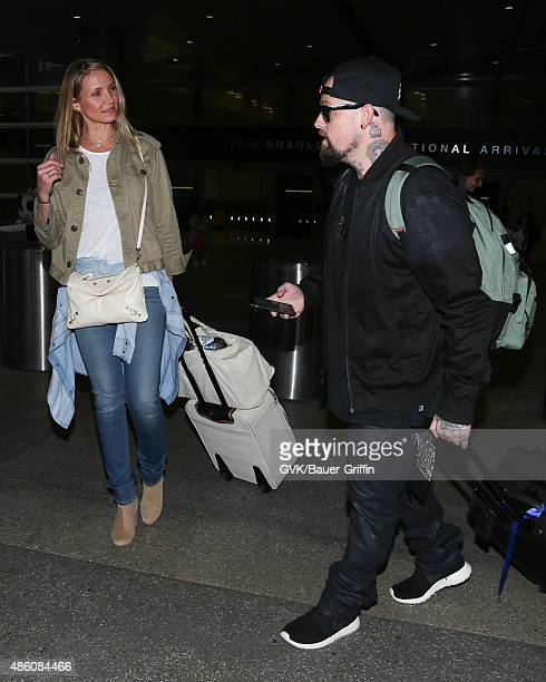 Cameron Diaz and Benji Madden are seen at LAX on August 31 2015 in Los Angeles California