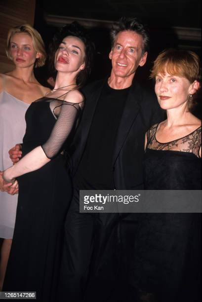 Cameron Diaz, Beatrice Dalle, Calvin Klein and Isabelle Huppert attend a Calvin Klein Party during A Paris Fashion Weeks in the 1990s in Paris,...