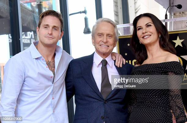 Cameron Douglas, Michael Douglas, and Catherine Zeta-Jones pose at the Michael Douglas Star On The Hollywood Walk Of Fame ceremony on November 6,...