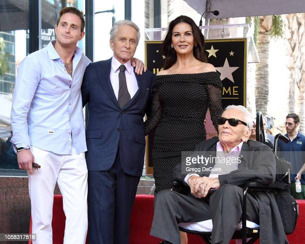 Cameron Douglas Michael Douglas Catherine ZetaJones and Kirk Douglas pose at the Michael Douglas Star On The Hollywood Walk Of Fame ceremony on...
