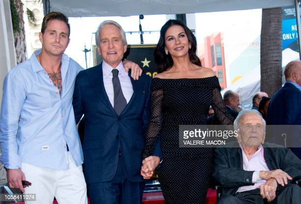 TOPSHOT Cameron Douglas Michael Douglas Catherine ZetaJones and Kirk Douglas attend the ceremony honoring actor Michael Douglas with a Star on...