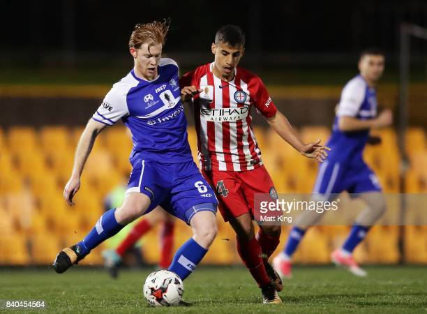 Cameron Draper of Hakoah is challenged by Daniel Arzani of Melbourne City during the FFA Cup round of 16 match between Hakoah Sydney City East and...