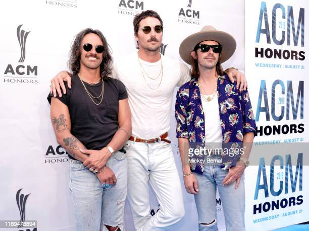 Cameron Duddy Mark Wystrach and Jess Carson of Midland arrive at the 13th Annual ACM Honors on August 21 2019 in Nashville Tennessee