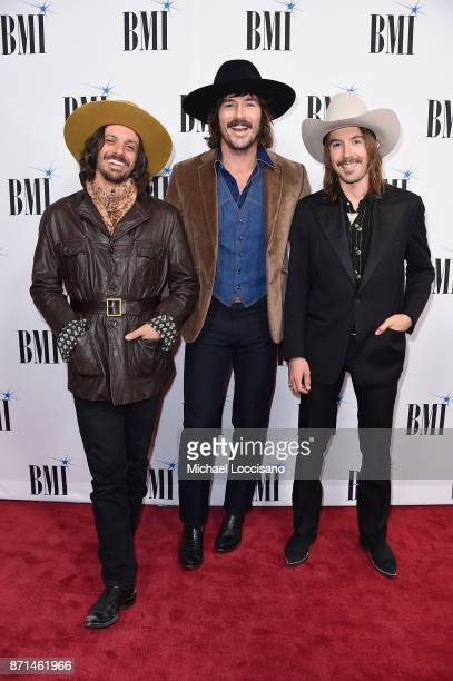 Cameron Duddy Mark Wystrach and Jess Carson of Midland attend the 65th Annual BMI Country awards on November 7 2017 in Nashville Tennessee