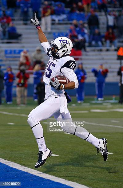Cameron EcholsLuper of the TCU Horned Frogs celebrates his 69yard punt return for a touchdown in the third quarter during a game against the Kansas...
