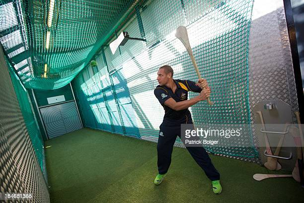 Cameron Ellis Yolmen of the AFL Australian International Rules team tries his hand at hurling during a visit to the GAA Museum at Croke Park on...