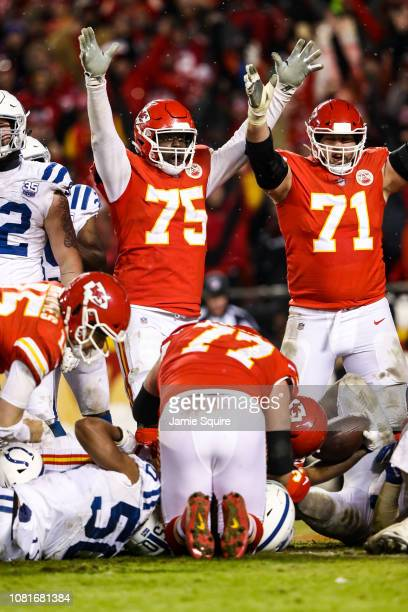 Cameron Erving of the Kansas City Chiefs and teammate Mitchell Schwartz signal a touchdown against the Indianapolis Colts during the fourth quarter...