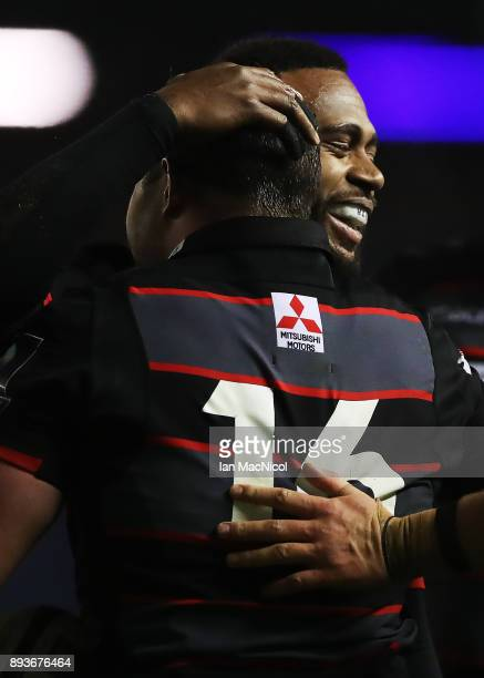 Cameron Fenton of Edinburgh is congratulated by Junior Rasolea after he scores his side's eleventh try during the European Rugby Challenge Cup match...