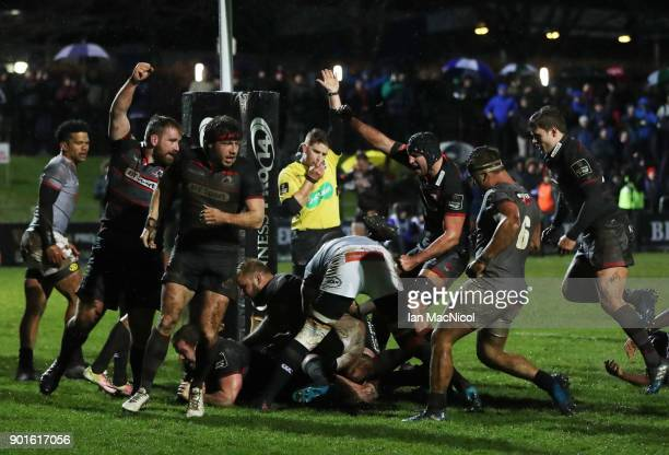 Cameron Fenton of Edinburgh Rugby team celebrates after he scores his team's fourth try during the Guinness Pro14 match between Edinburgh Rugby and...
