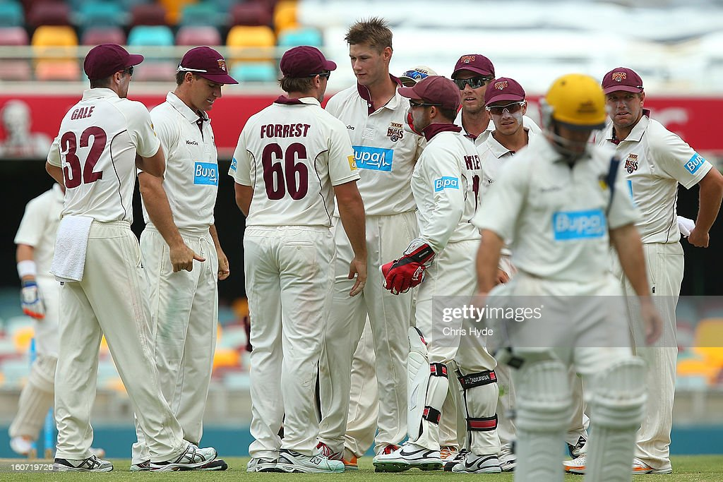 Cameron Gannon of the Bulls celebrates with team mates after dismissing Liam Davis of the warriors during day two of the Sheffield Shield match between the Queensland Bulls and the Western Australia Warriors at The Gabba on February 5, 2013 in Brisbane, Australia.
