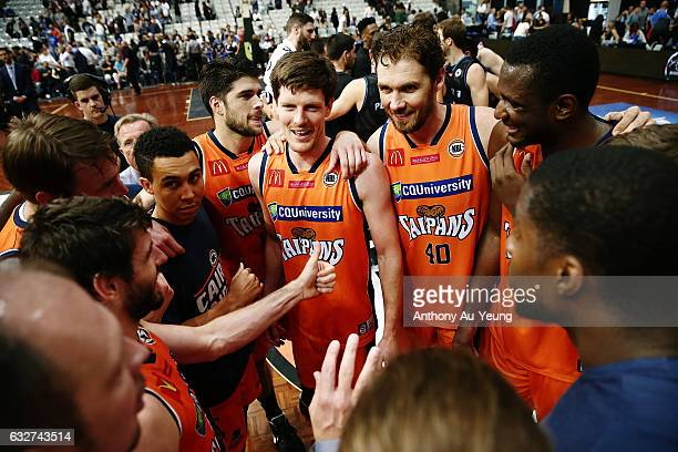 Cameron Gliddon and Alex Loughton of the Taipans celebrate with the team after winning the round 17 NBL match between the New Zealand Breakers and...