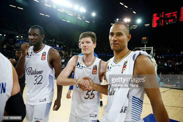 Cameron Gliddon and Mika Vukona of the Bullets celebrate after winning the round one NBL match between the New Zealand Breakers and the Brisbane...