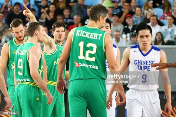 Cameron Gliddon of the Boomers gestures to the scoreboard to Ying Chun Chen of Chinese Taipei during the FIBA World Cup Qualifying match between the...