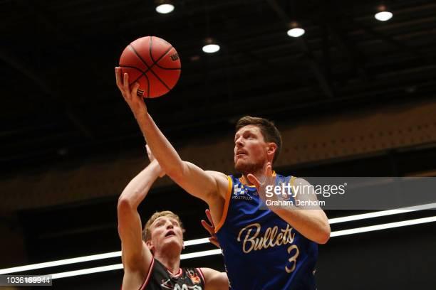 Cameron Gliddon of the Brisbane Bullets drives at the basket during the NBL Blitz pre-season match between Brisbane Bullets and Illawara Hawks at...