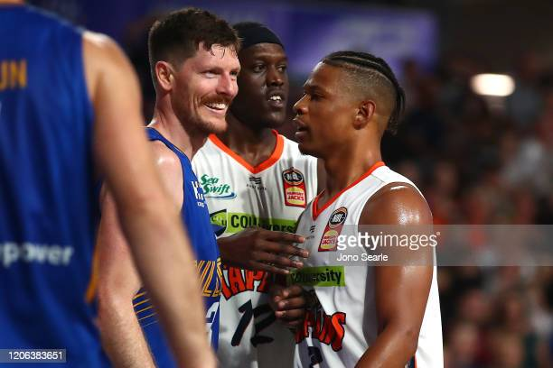 Cameron Gliddon of the Bullets and Scott Machado of the Taipans exchange words after a foul during the round 20 NBL match between the Brisbane...