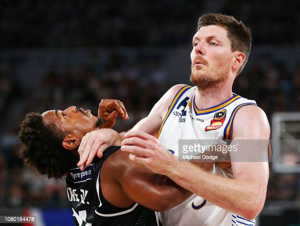 Cameron Gliddon of the Bullets blocks Casper Ware of United during the round eight NBL match between Melbourne United and the Brisbane Bullets at...