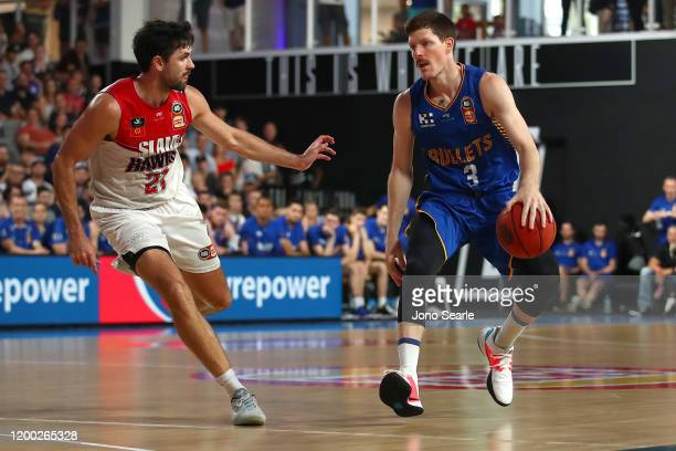Cameron Gliddon of the Bullets dribbles the ballduring the round 16 NBL match between the Brisbane Bullets and the Illawarra Hawks at Nissan Arena on...
