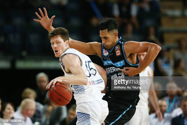 Cameron Gliddon of the Bullets drives against Tai Wesley of the Breakers during the round one NBL match between the New Zealand Breakers and the...