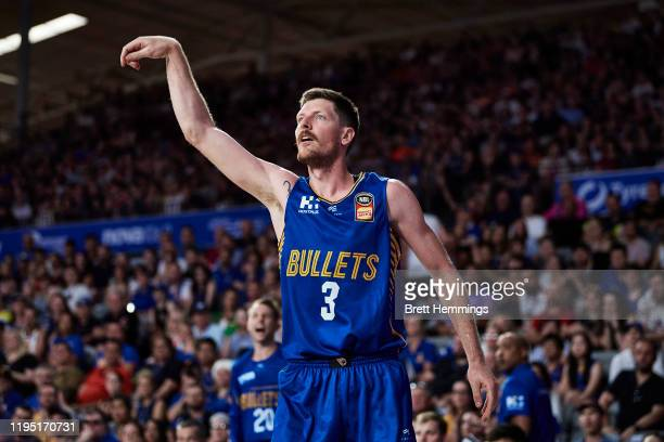 Cameron Gliddon of the Bullets looks on after shooting for 3 during the round 12 NBL match between the Brisbane Bullets and the Sydney Kings at...