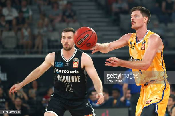 Cameron Gliddon of the Bullets passes during the round 13 NBL match between Melbourne United and the Brisbane Bullets at Melbourne Arena on December...