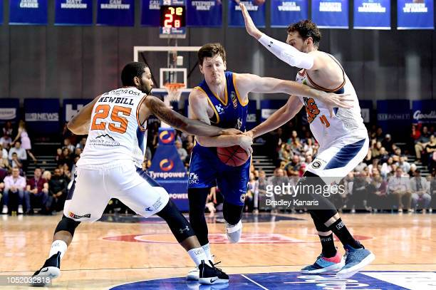 Cameron Gliddon of the Bullets takes on the defence during the round one NBL match between the Brisbane Bullets and the Cairns Taipans at Brisbane...