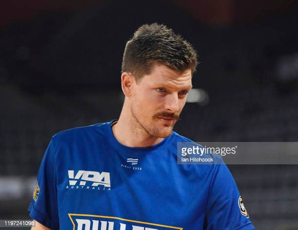 Cameron Gliddon of the Bullets warms up before the start of the round 14 NBL match between the Cairns Taipans and the Brisbane Bullets at the Cairns...