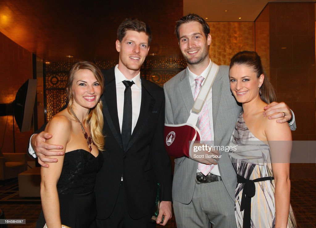Cameron Gliddon (2nd L) of the Cairns Taipans and his partner Sarah Lindley along with Mark Worthington (2nd R) and his wife Andrea Worthington attend the 2013 Basketball Australia MVP Awards at Crown Palladium on March 24, 2013 in Melbourne, Australia.